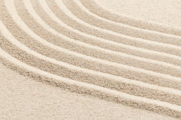 Fondo strutturato dell'onda della sabbia di zen nel concetto di consapevolezza