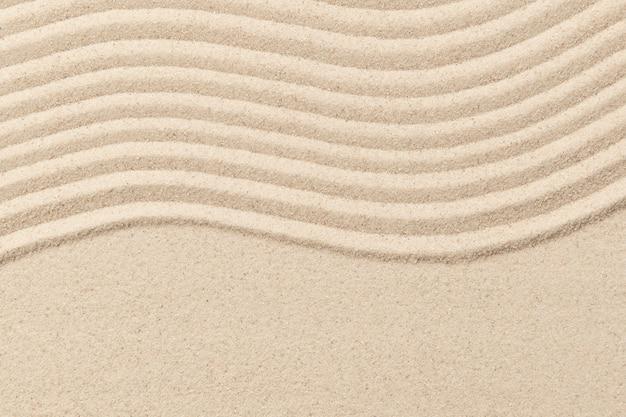 Fondo strutturato dell'onda della sabbia di zen nel concetto di benessere