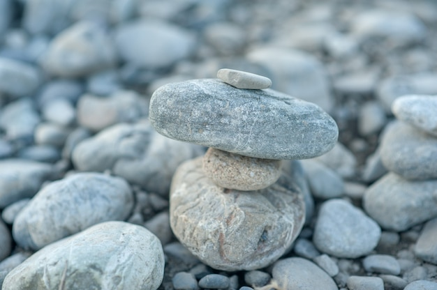 Zen stone pyramid neutral background