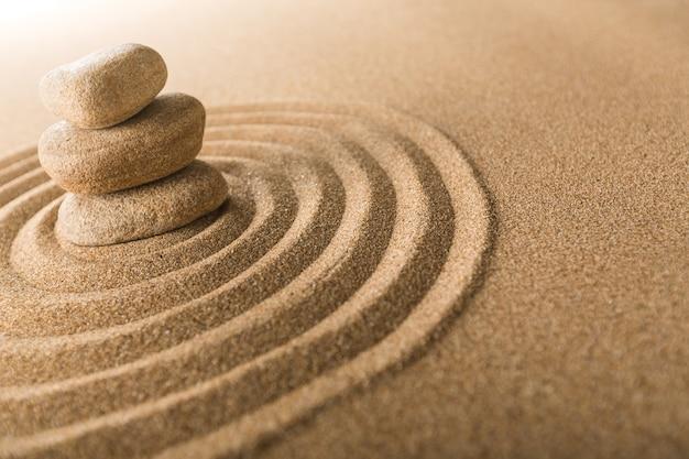 Zen stones in the sand. background