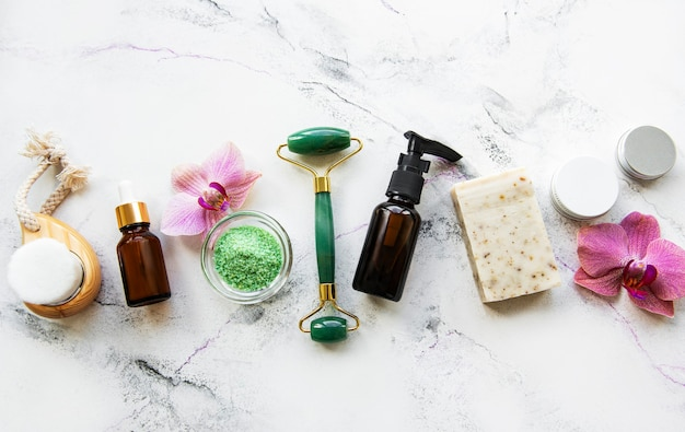 Zero waste bathroom accessories and jade roller on a marble surface