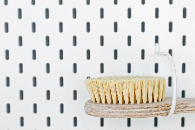 Zero waste bathroom accessories, natural sisal brush eco body, showers brush copy space white background