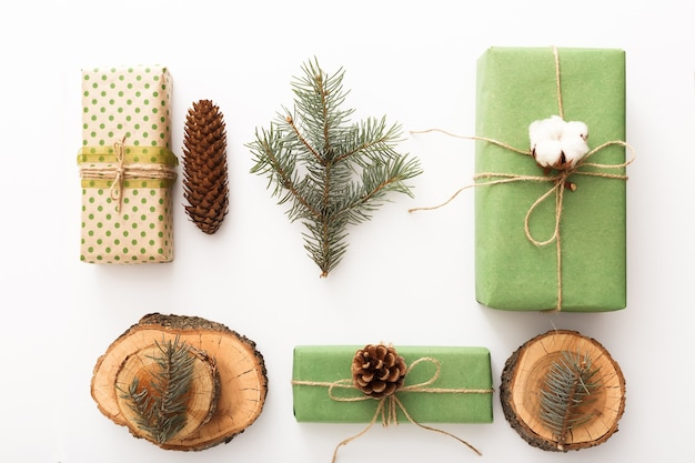 Zero waste christmas composition background made of pine cones, branches, candle, tree rings, crafted gifts with no plastic on white table. top view, close up, copy space, background, flat lay.