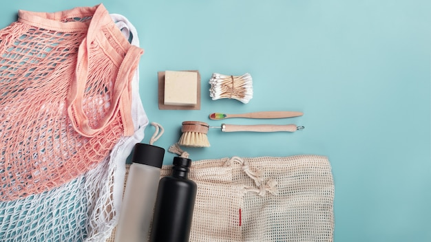 Zero waste concept cotton bags, reusable water bottles and eco friendly accessories