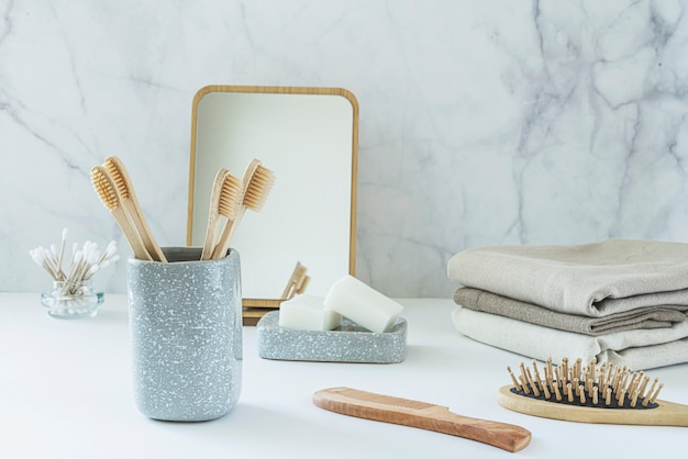 Zero waste concept. set of eco friendly bathroom accessories - bamboo toothbrushes, cotton buds, natural hairbrush, mirror and linen napkines. sustainable lifestyle.