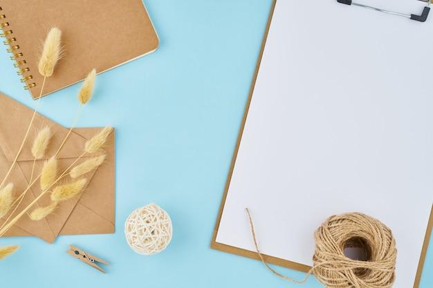 Zero waste concept. white sheet on clipboard, craft envelopes