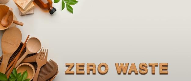 ゼロウェイストのコンセプト、木製の台所用品と白い背景のコピースペース、創造的なシーン