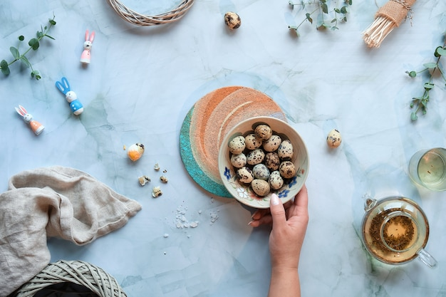 Zero waste easter background on marble table. quail easter eggs and natural spring decorations and eucalyptus twigs.