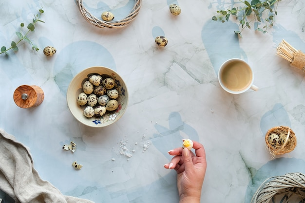 Zero waste easter background on marble table. quail easter eggs and natural spring decorations, twigs and eucalyptus.