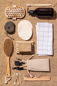 Zero waste, eco friendly bathroom accessories on burlap fabric