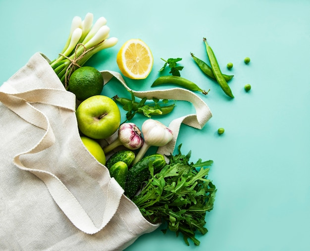Zero waste food shopping. eco natural bags with fruits and vegetables, eco friendly, flat lay.