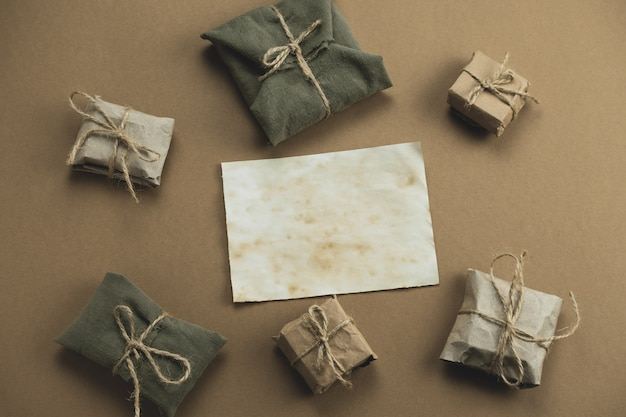 Zero waste gift boxes wrapped in paper and textile on brown