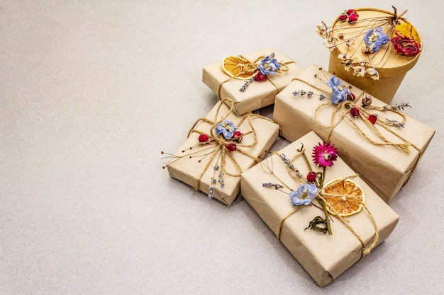 Zero waste gift concept. birthday eco friendly packaging. festive boxes in craft paper with different organic decorations.
