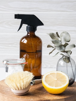 Zero waste home cleaning concept. various items and ingredients for eco home cleaning on wood board
