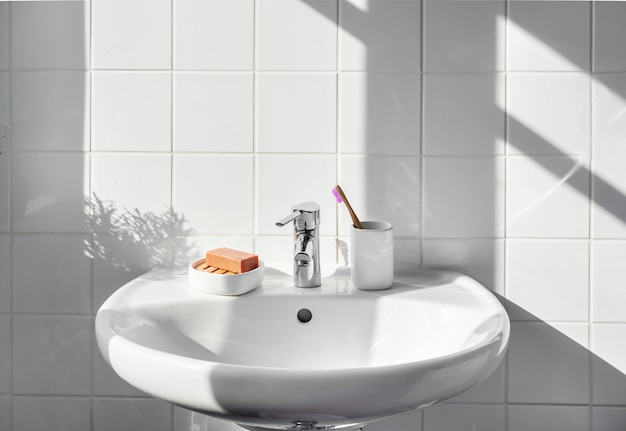 Zero waste items such as bamboo toothbrush, glass, organic soap  white bathroom