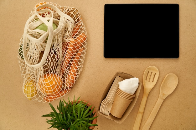 Zero waste reuse refuse recycle concept flat lay, string bag and wooden cultery, app template