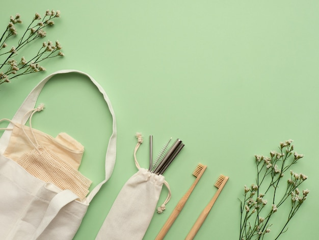 Zero waste starter kit on green background, top view