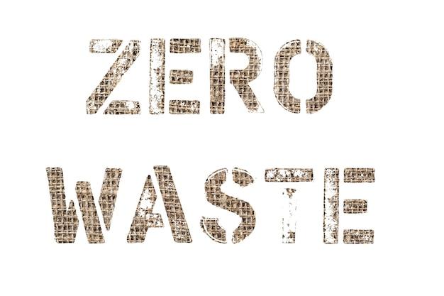 廃棄物ゼロ。古い繊維の背景写真のテキスト カット、白い背景の上の碑文