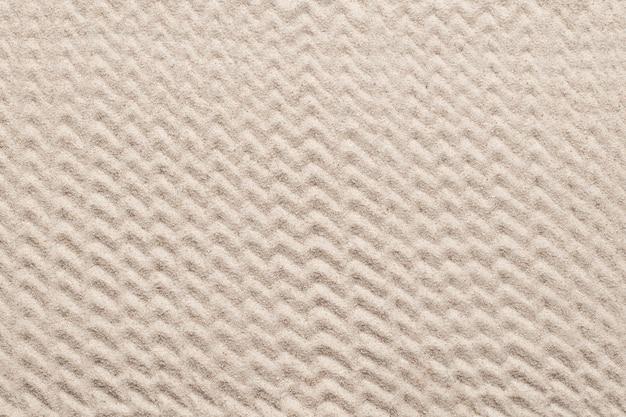 Зигзагообразный узорчатый песок текстурированный фон в концепции оздоровления