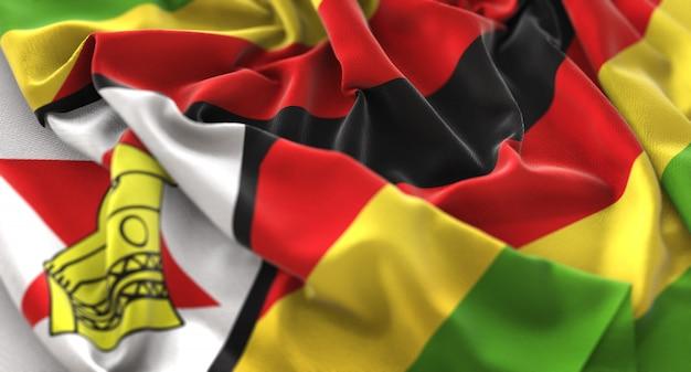 짐바브웨의 국기 뻗 치고 아름 답게 흔들며 매크로 클로즈업 샷