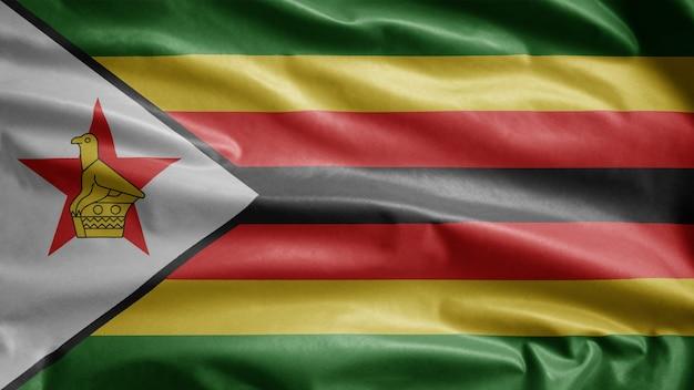 바람에 물결 치는 짐바브웨 국기