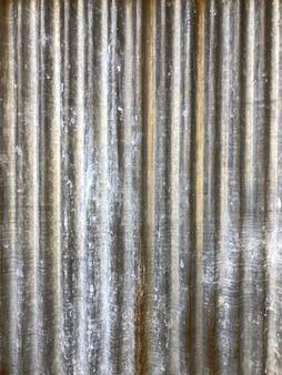 그것에 녹슨 쓰레기와 벽지 및 배경 옆에 아연 패턴.
