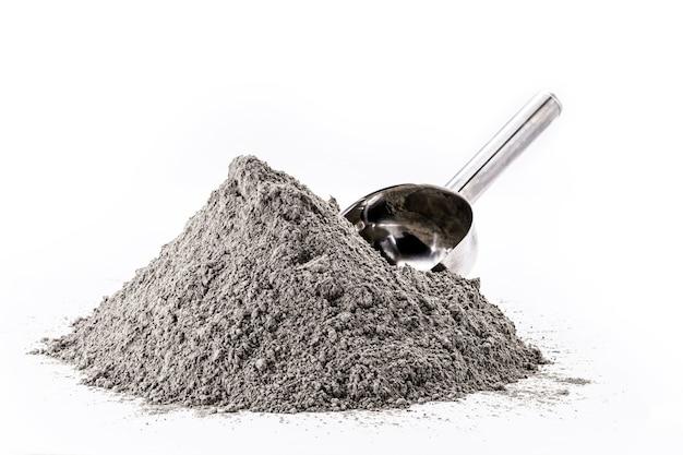 Цинковый порошок серого цвета, используемый в фармацевтической промышленности. Premium Фотографии