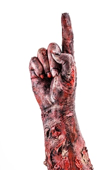 Zombie hand doing number one, okay, countdown. halloween hand, isolated white surface.