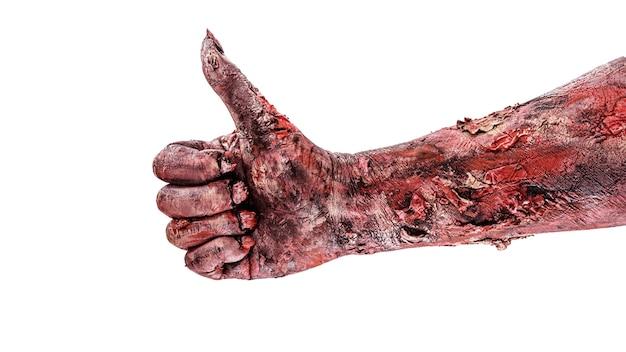 Рука зомби делает жест лайка или одобрения. рука хэллоуина, изолированная белая поверхность.