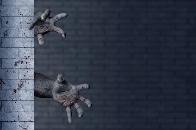 廃墟となった建物のレンガの壁の後ろに血と傷を負ったゾンビの手