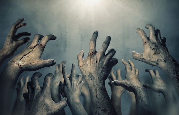 Zombie hands rising in dark halloween night.
