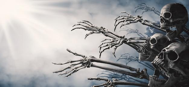 Zombie skeleton hand rising in dark halloween night.