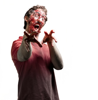 Zombie with bloody raised arms