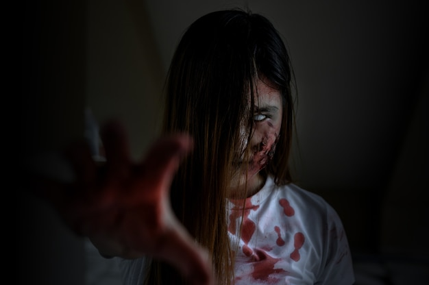 Zombie woman costume and makeup for halloween festival. scary ghost with horror and darkness scene.