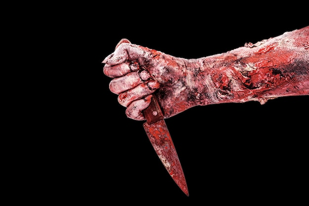 Zombies or monsters hand attacking, attack or nightmare concept, isolated black background