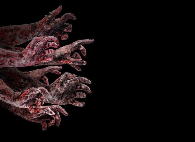 Зомби или монстры рука атакуют, атакуют или концепцию кошмара, изолированный черный фон