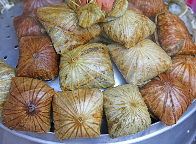 Zongzi , chinese rice dumplings in lotus leaf.