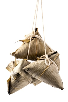 Zongzi, rice dumpling - design concept of famous food in duanwu dragon boat festival, close up, clipping path, cut out, isolated on white background