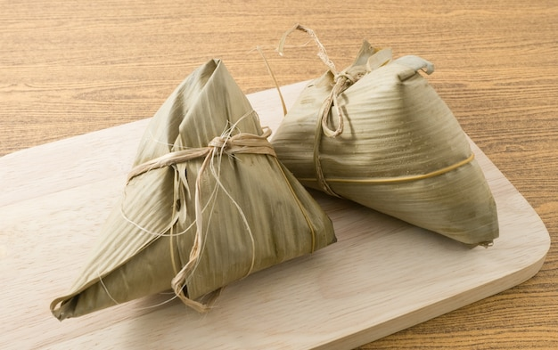 Zongzi or sticky rice dumpling served on wooden board
