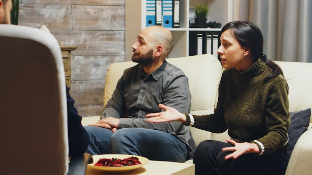 Zoom in shot of angry young wife at couples therapy. psychologist in couple difficulties.