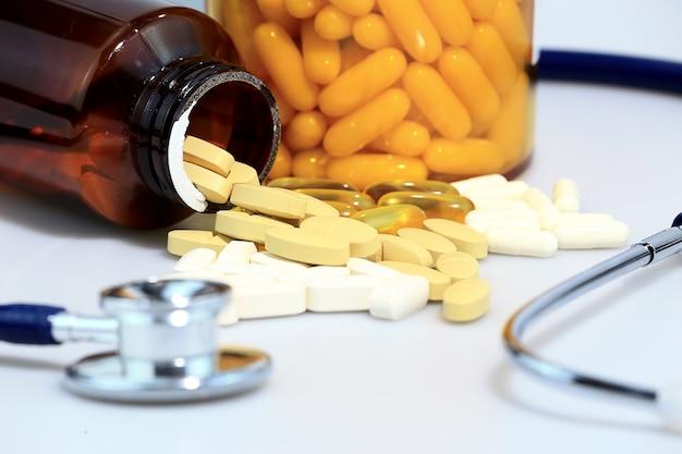 Zoom shot of drug and  stethoscope, medical concept. Premium Photo