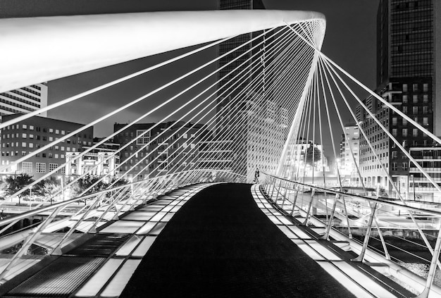 Zubizuri bridge in bilbao basque country spain. in black and white monochrome. spain.