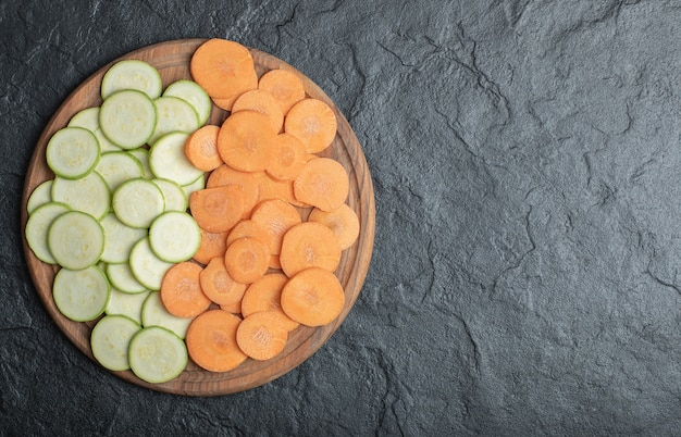 Zucchini and carrot slices on black background. high quality photo
