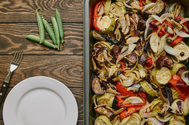 Zucchini eggplant black carrots sweet pepper and mushrooms baked vegetables