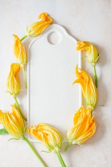 Zucchini flowers on a white board