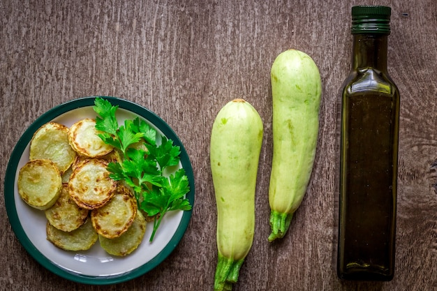 Zucchini, fried in batter on dish on a wooden background. top view. copy space. still life. flat lay
