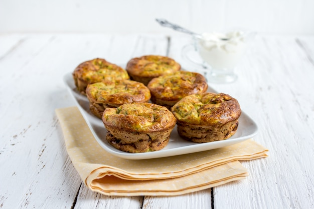 Zucchini muffins with herbs