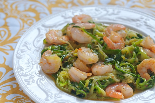 Zucchini spaghetti pasta with shrimps on a plate