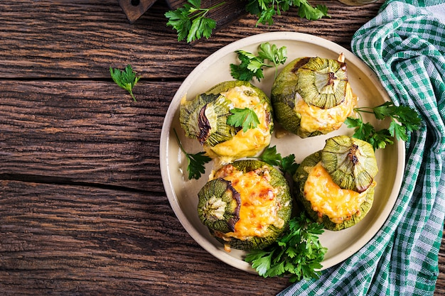 Zucchini stuffed with minced meat, cheese and green herbs