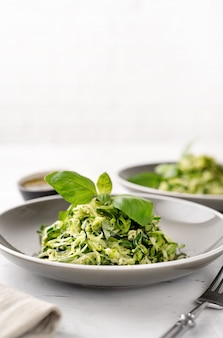 Zucchini vegan pasta on white background. vegan food